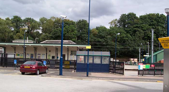 Four Oaks station entrance from car park